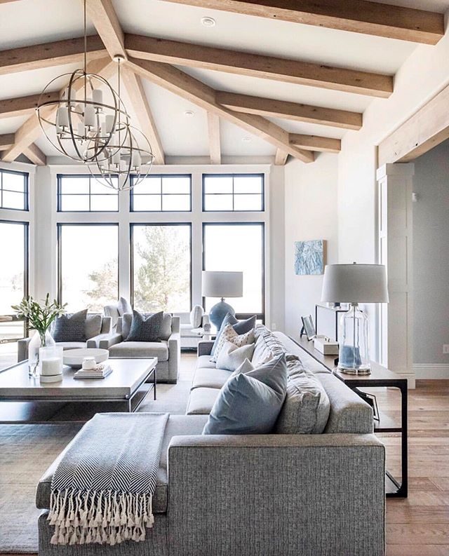Now this is a living room I would quite happily live in....forever 😁. How open and airy does it look! This is thanks to those amazing high ceilings and beautiful windows! And did you see the last image😍. It even has a fireplace 🔥🙌. . Design by @ktmarshalldesign 📷 | @kellikroneberger  builder | @brannenhomes . . . #highceilings #exposedbeams #steelwindows #blackwindows #windowlove #cathedralceiling #hamptonstyle #brightandairy #livingroomdesign #familyroomdesign #familyroomdecor #fireplace #stonefireplace #livingroomdecor #livingroomideas #interiordesign #interiorinspo #interiordecor #instadecor #instahome #whitehome #instastyling #interiorstyling #luxuryhome #eleganthome