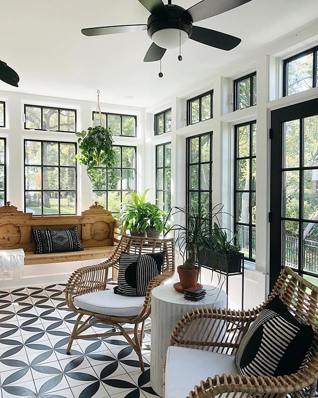 Is it the weekend yet? I'm ready to chill out and a sunroom like this would be the perfect place to do just that!. How beautiful are all those black windows and tiles😍.....perfect spot to wind down with a book 📚. Gorgeous space via @jeanstofferdesign💕 . . . #sunroom #sunroomdecor #sunroomdesignidea #blackwindows #windowlove #windowdesign #tiledesign #floortiles #blackandwhitedecor #livingroomdecor #livingroomdesign #interiordesign #interiordecor #interior4you1 #instahome #instahomedecor #houseandgarden