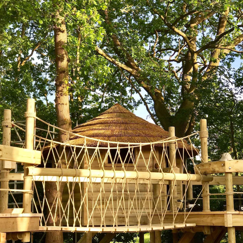 """...beautiful treehouse fixed-beam rope bridge"""