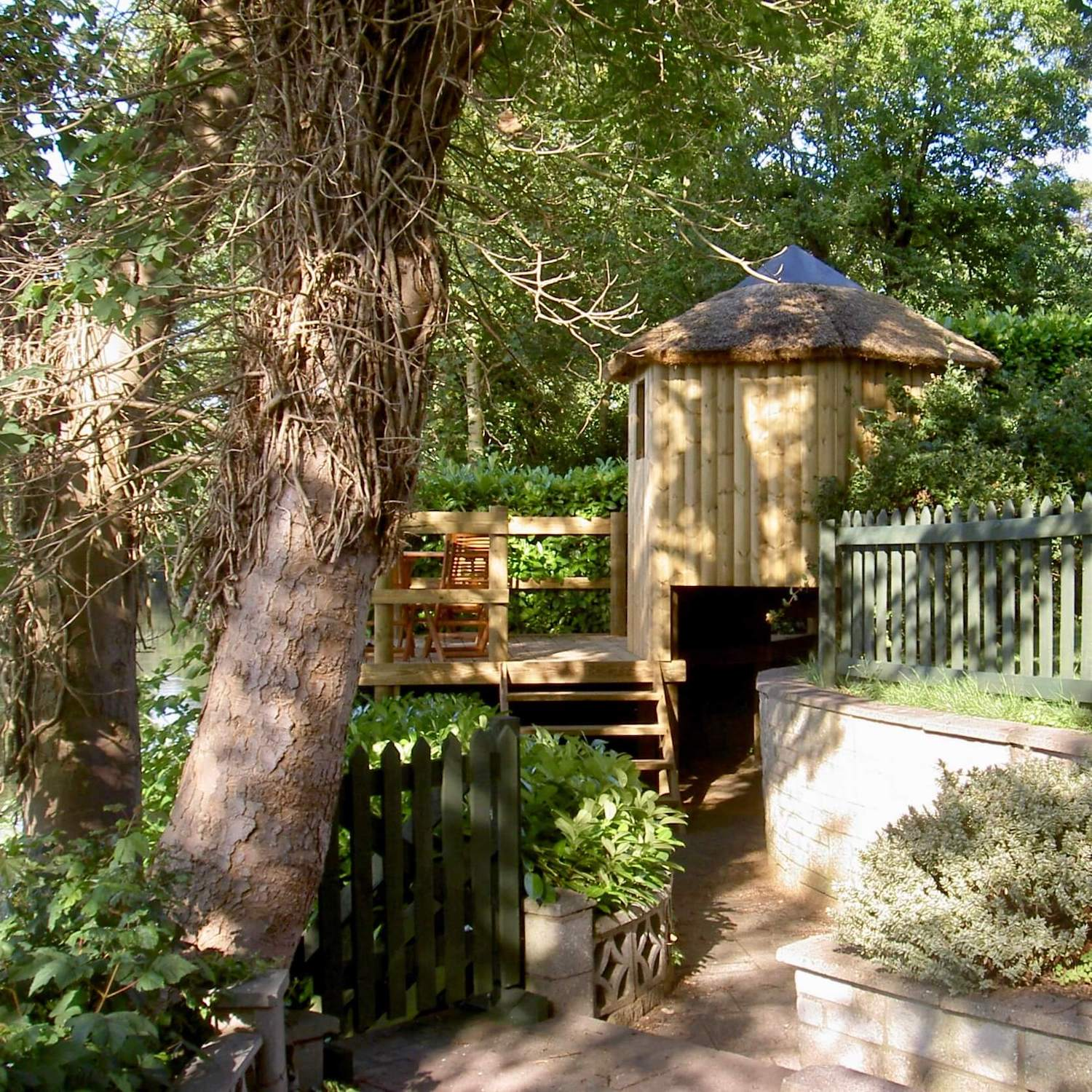 """""""...treehouse and deck set into garden"""""""