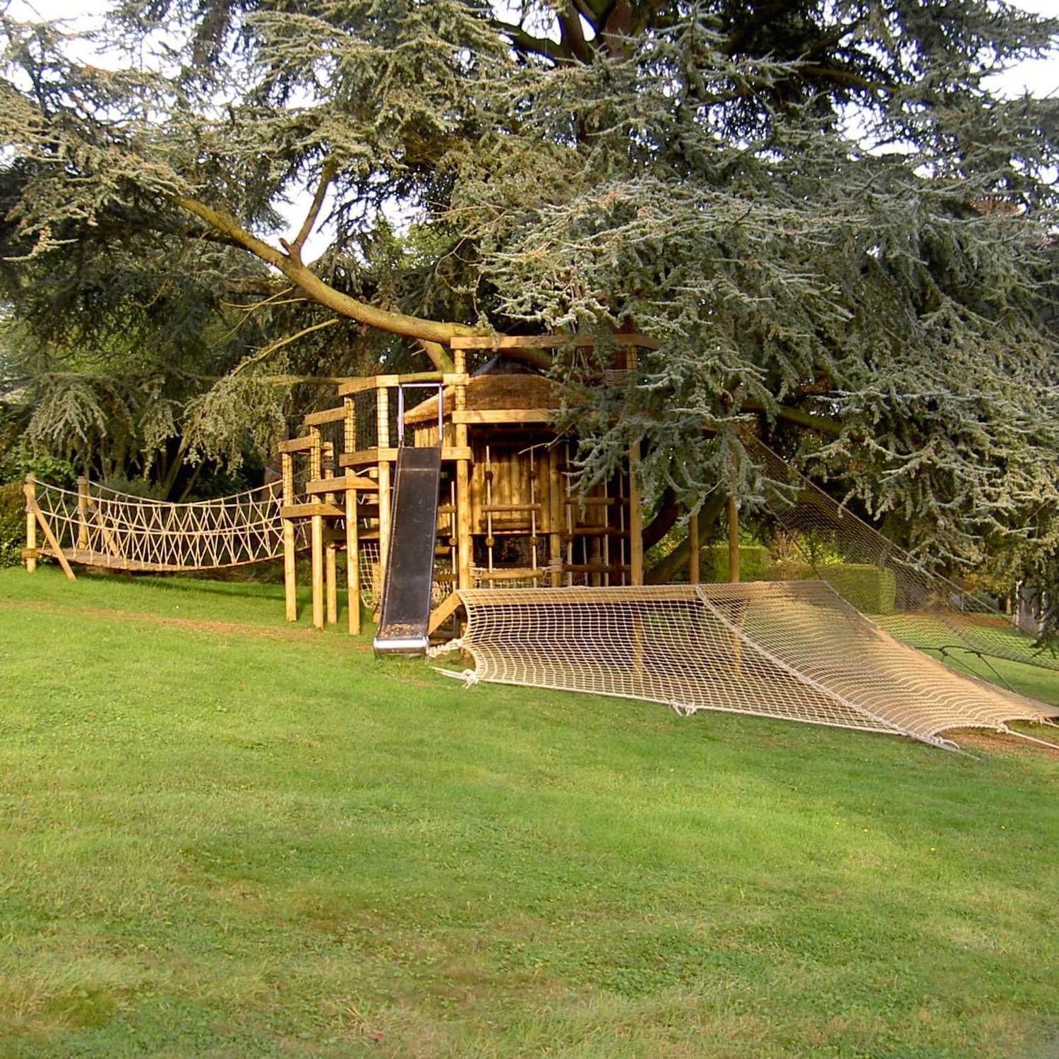 """...treehouse with large slide, rope bridge and scramble net"""