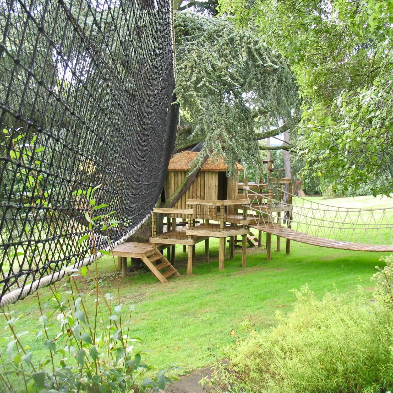 """...treehouse leading to treetop walkway"""