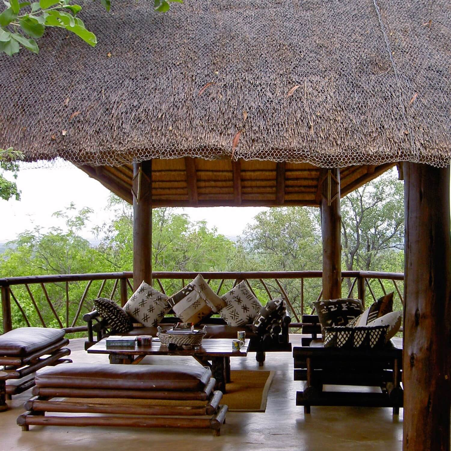 """...outdoors lounge under thatch"""
