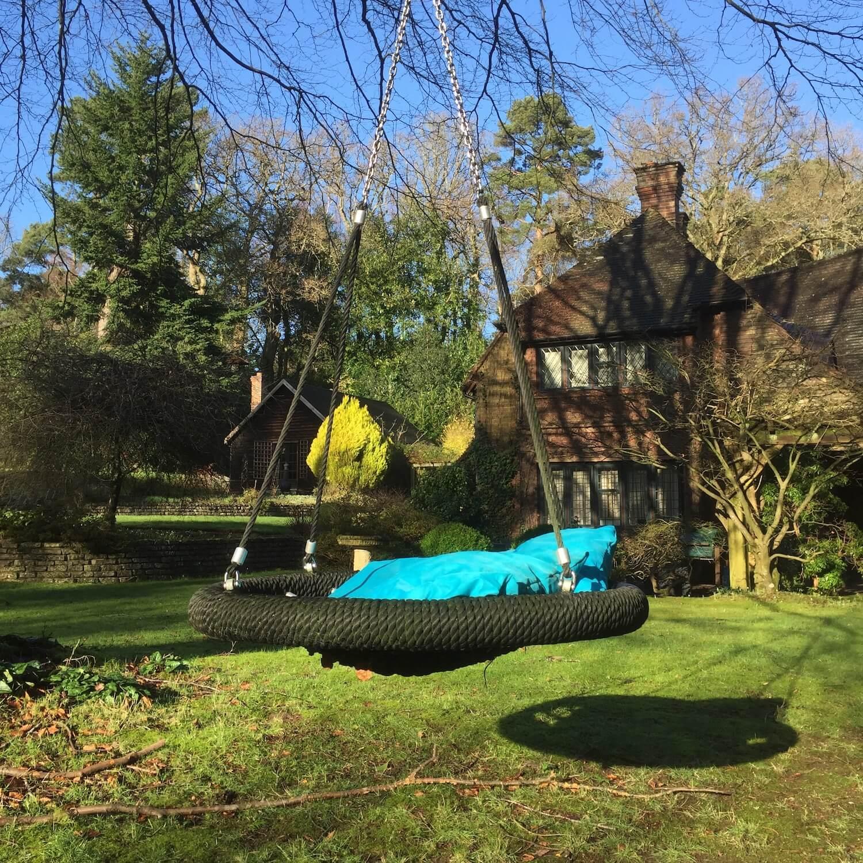 Nest Swing plus cushions in garden.jpeg