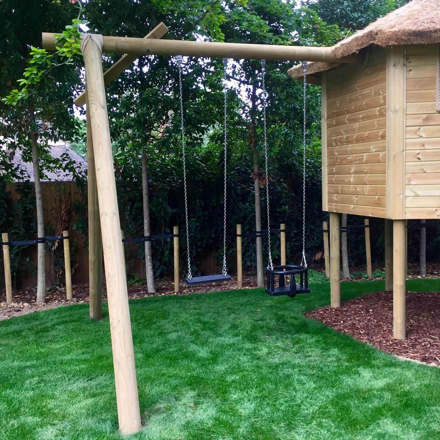 """...'A' frame swing set attached to a treehouse"""