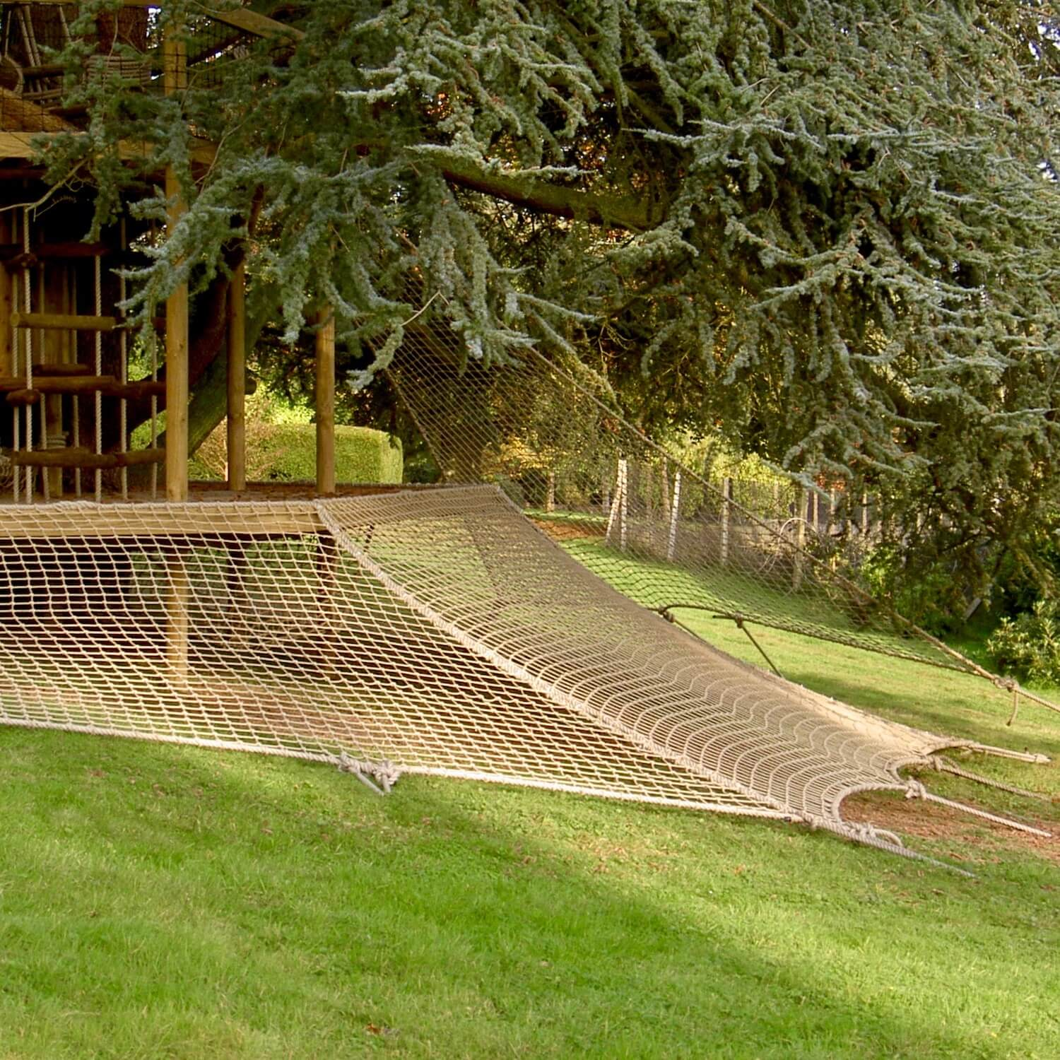 """""""....scramble net wrapping a large treehouse deck"""""""