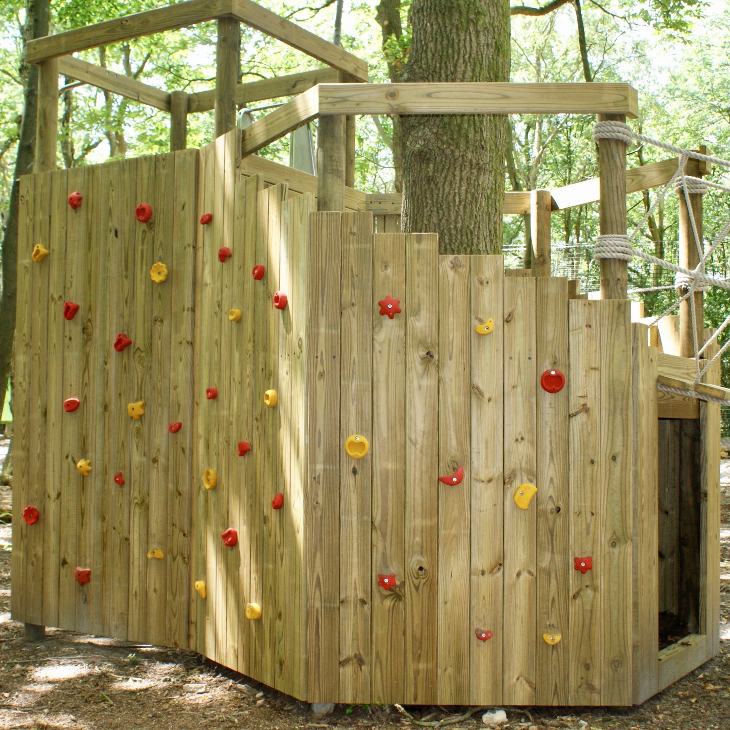 """""""...climbing and bouldering wall wrapping a woodland platform"""""""