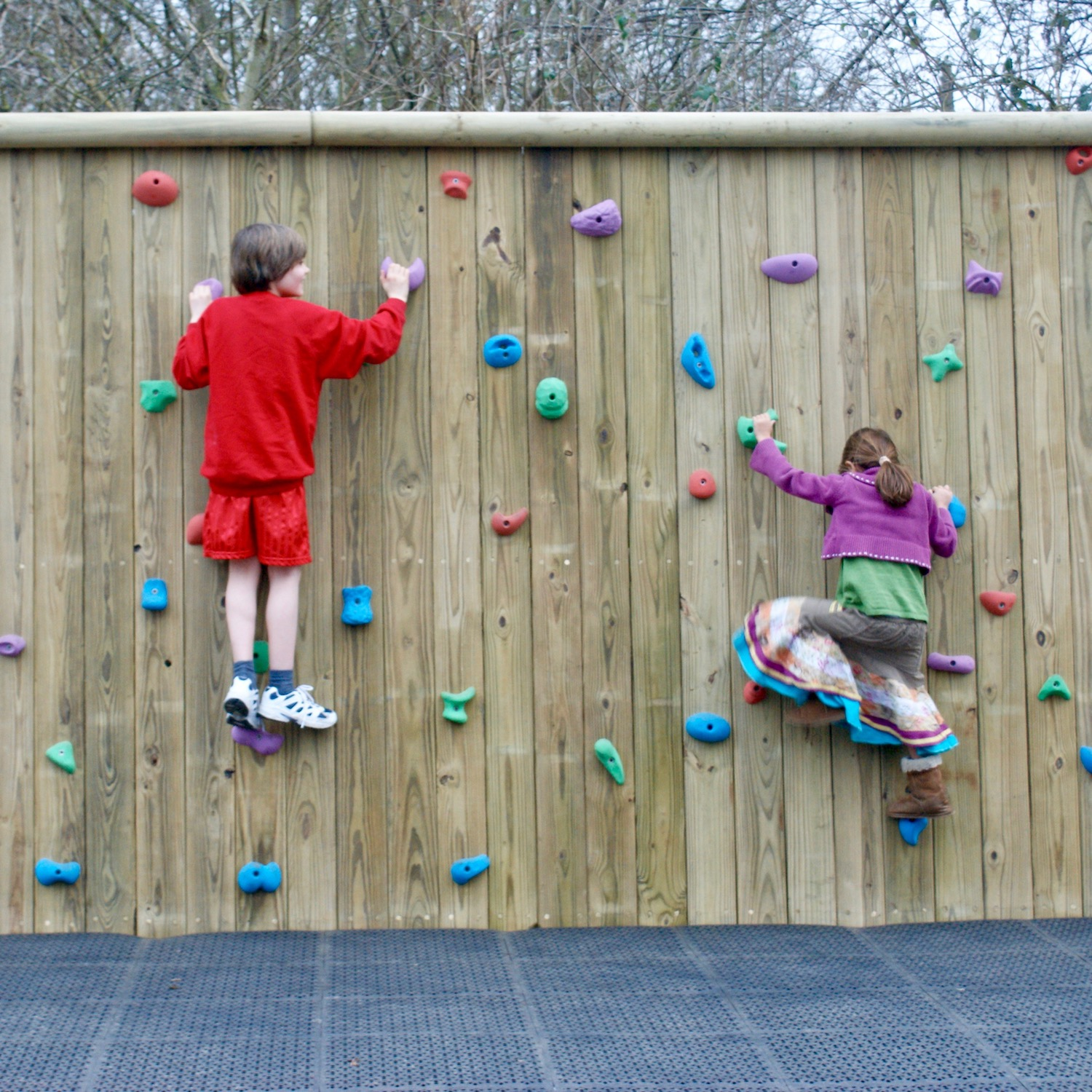 """""""...playground bouldering wall with soft fall surface"""""""