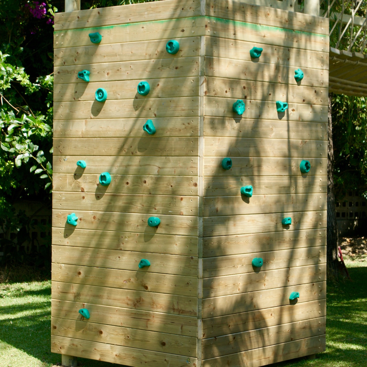 """""""...climbing wall wrapping a treehouse platform deck"""""""