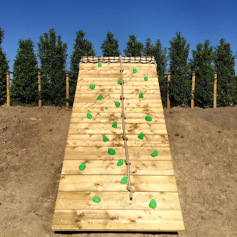"""...big ground based climbing wall on garden slope"""