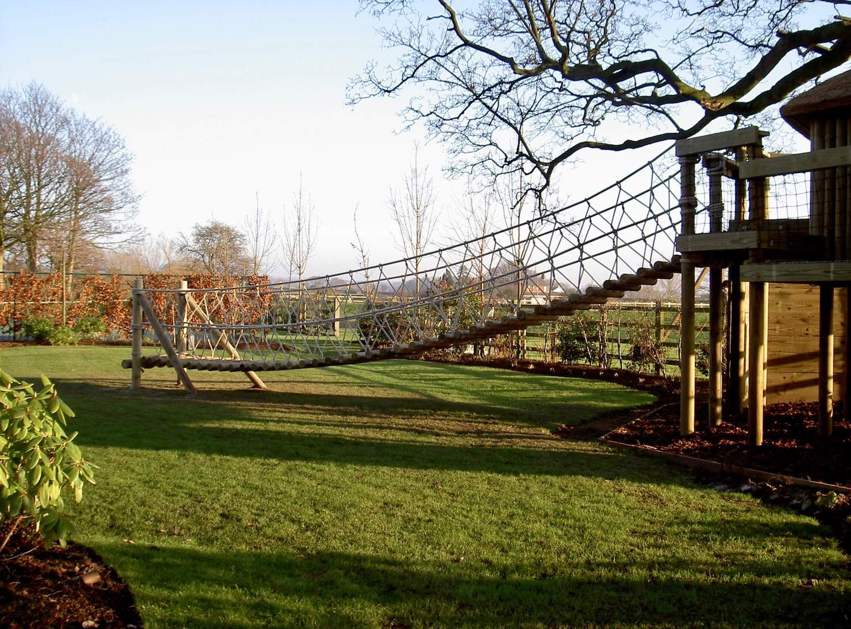 """...rope bridge leading to treehouse decks"""