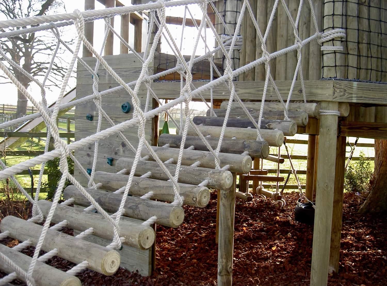 """...beautiful log rope bridge leading to treehouse"""