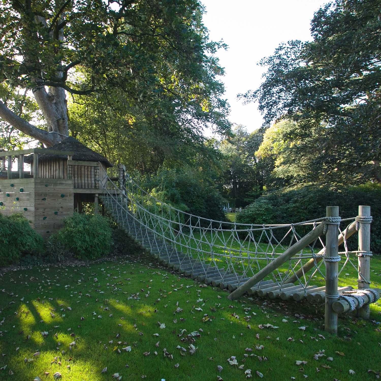 """...stunning treehouse and log rope bridge"""