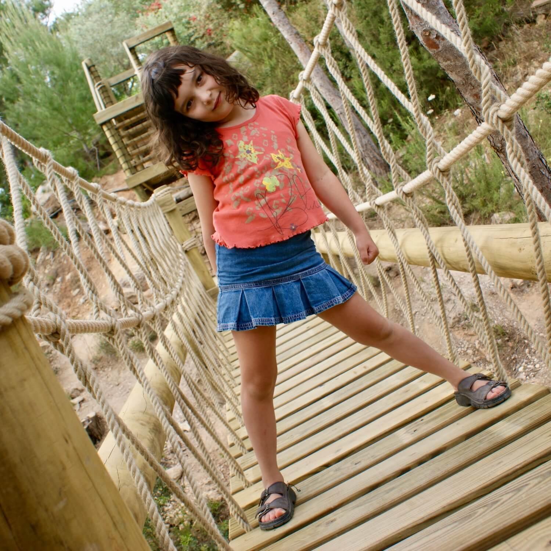 """...girl playing on rope bridge"""