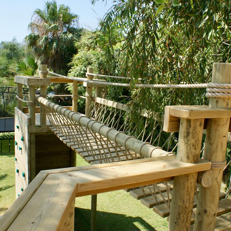 """...treehouse rope bridge leading to platform"""