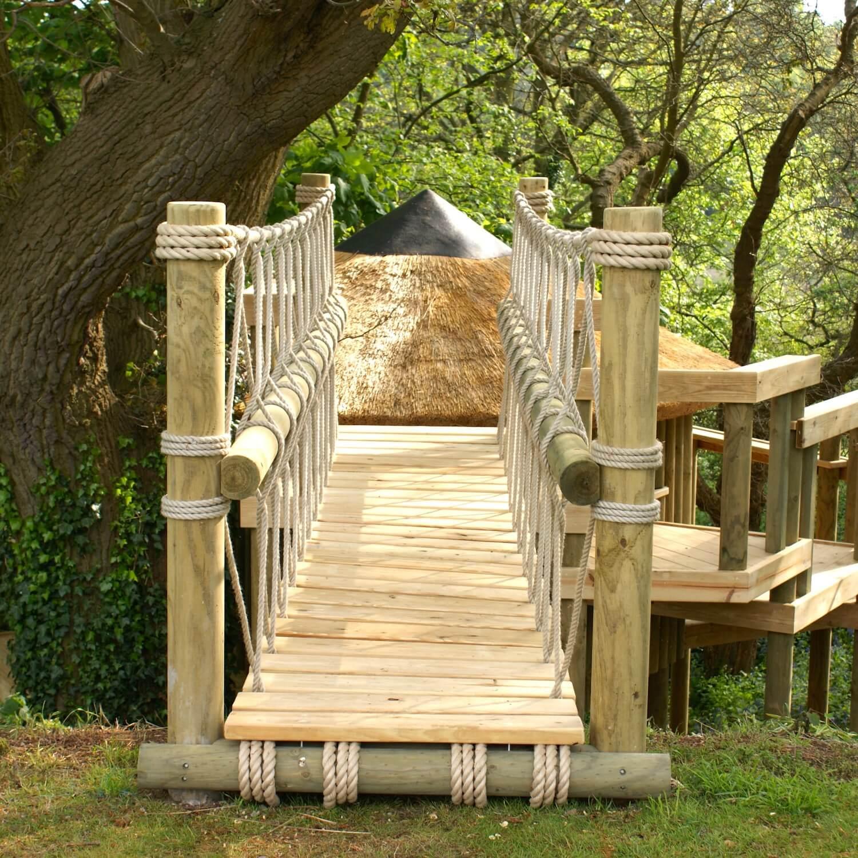 """...log entrance to rope bridge"""