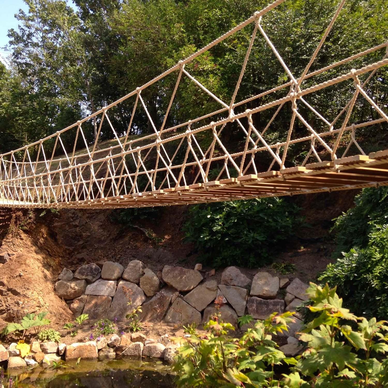 """""""...rope bridge across a garden lake"""""""