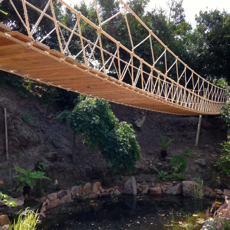 """""""...rope bridge over a garden lake"""""""