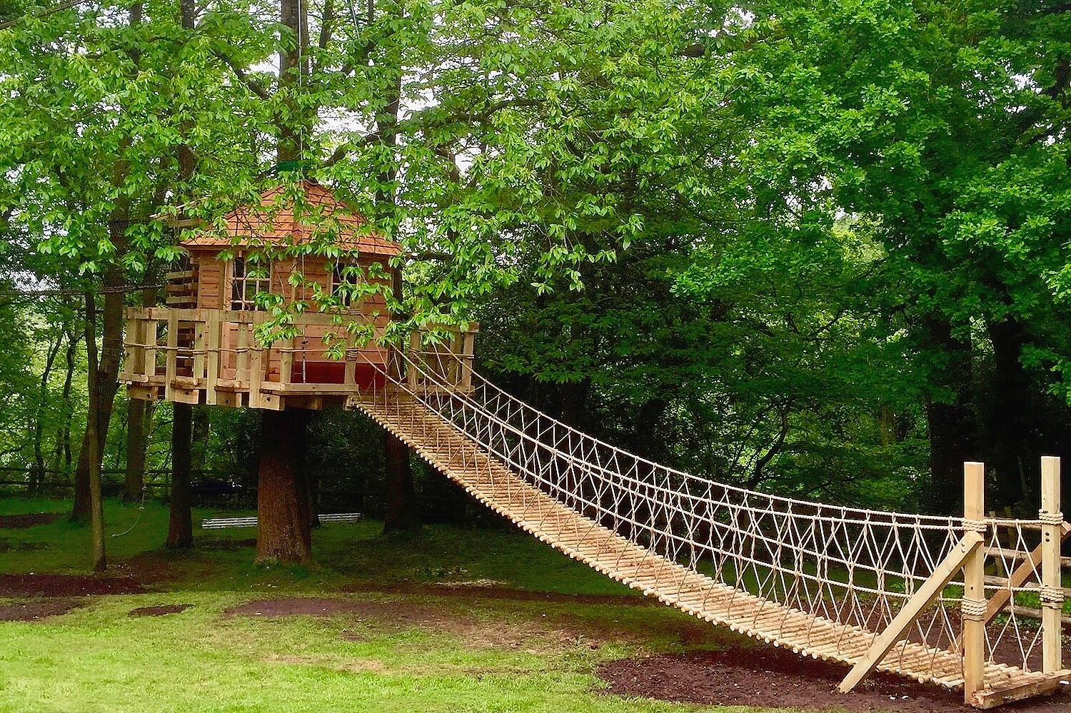 Rope Bridges for treehouses in gardens and woodlands for families, private clients and landscape designers.  More images of this project >
