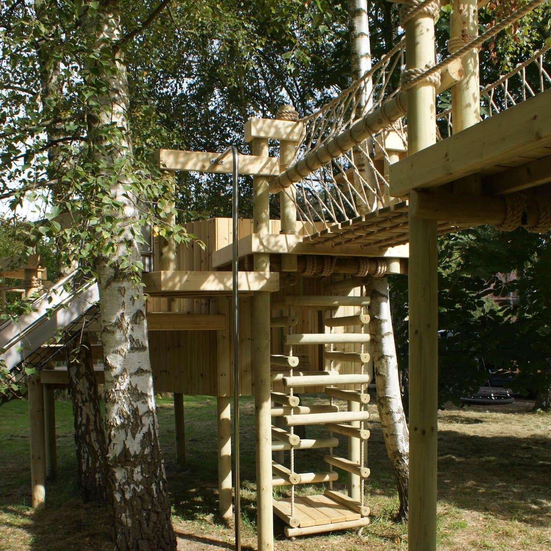 """...rope bridge between treehouse decks and platforms"""