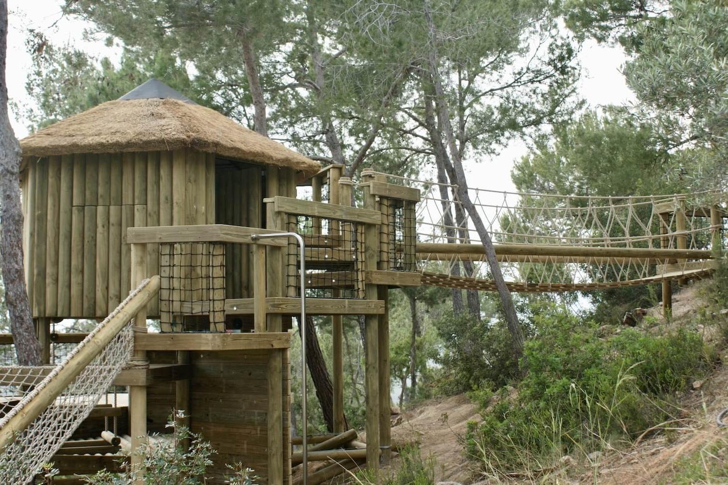 """...rope bridge entrance into treehouse"""