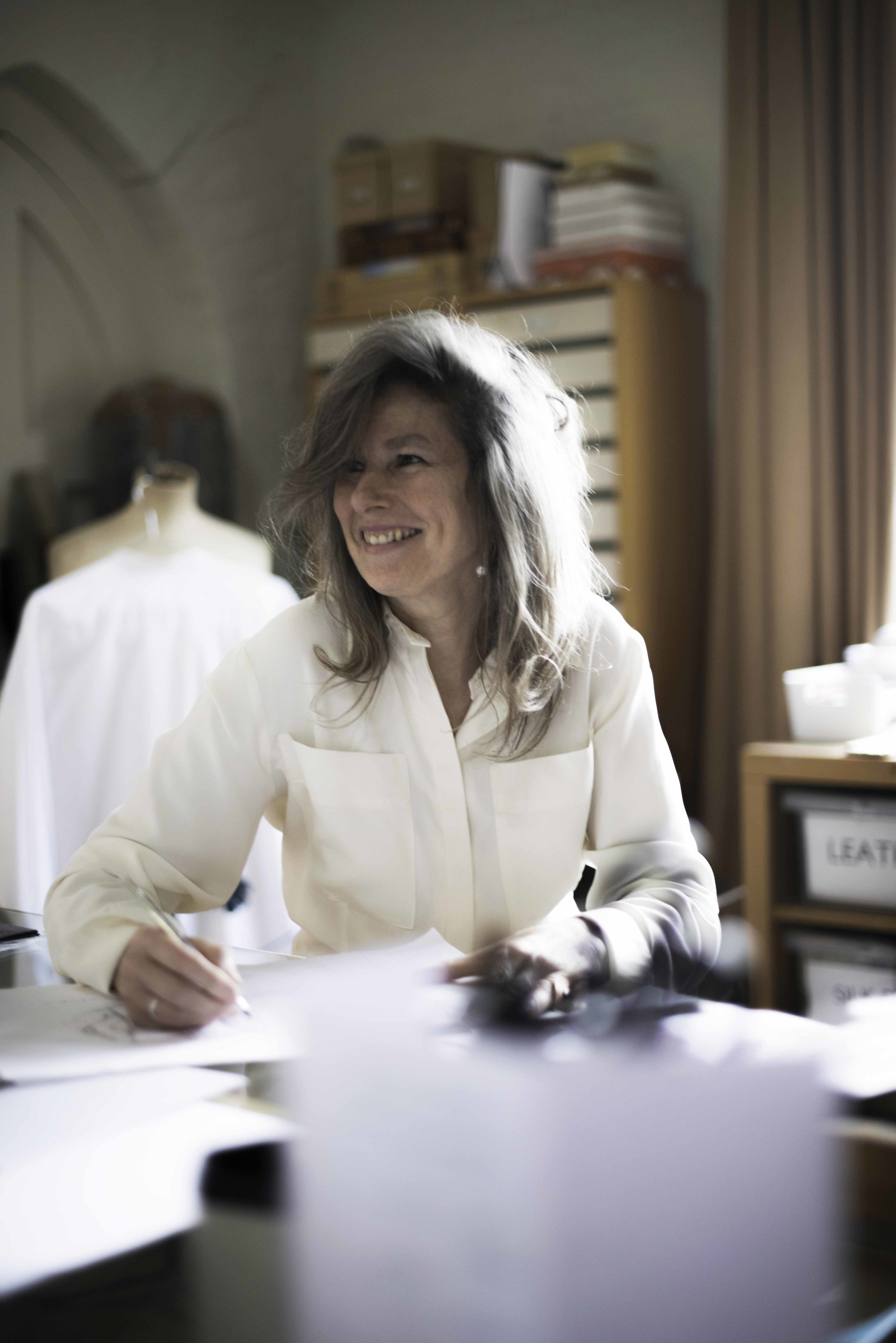 Jenny Mort - Having spent her childhood between Africa and the English countryside, both of which inspired a love of all things wild and wonderful, Jenny spent several years as a personal design assistant to Jean Muir in her Mayfair studio absorbing her qualities of precision and perfection.She then began developing her own textile product ranges for, amongst others, Harrods, Barney's New York, Seibu Japan, The British Museum and The Royal Academy at the same time as receiving commissions for several prestigious interior design projects. A best -selling children's range followed; then, having successfully run her own accessories company whilst simultaneously completing special projects for Armani and British Airways, Jenny returned to her first love: fashion.Fired by a deep desire to preserve the age old British textile traditions of embroidery, smocking, weaving, knitting and hand finishing, Jenny set up her own label, Jenny M. London, which was quickly taken up by the legendary Joan Burstein of Brown's where it has sold for several seasons.This is an individual contemporary collection for the confident and independent woman.Collectable pieces, either statement and standing alone, or layered, working seamlessly together to create a number of looks:-easy, relaxed, chic, artistic utility or timeless elegance.Simplicity and clean lines and a neutral, natural palette in crisp cotton organdies, linens, fine jerseys, soft cashmere and a touch of silk combine to luxurious effect.All made in the UK and with a philosophy to keep British artisan and atelier skills alive, Jenny M. is the essence of artful, effortless style.jennymlondon.com