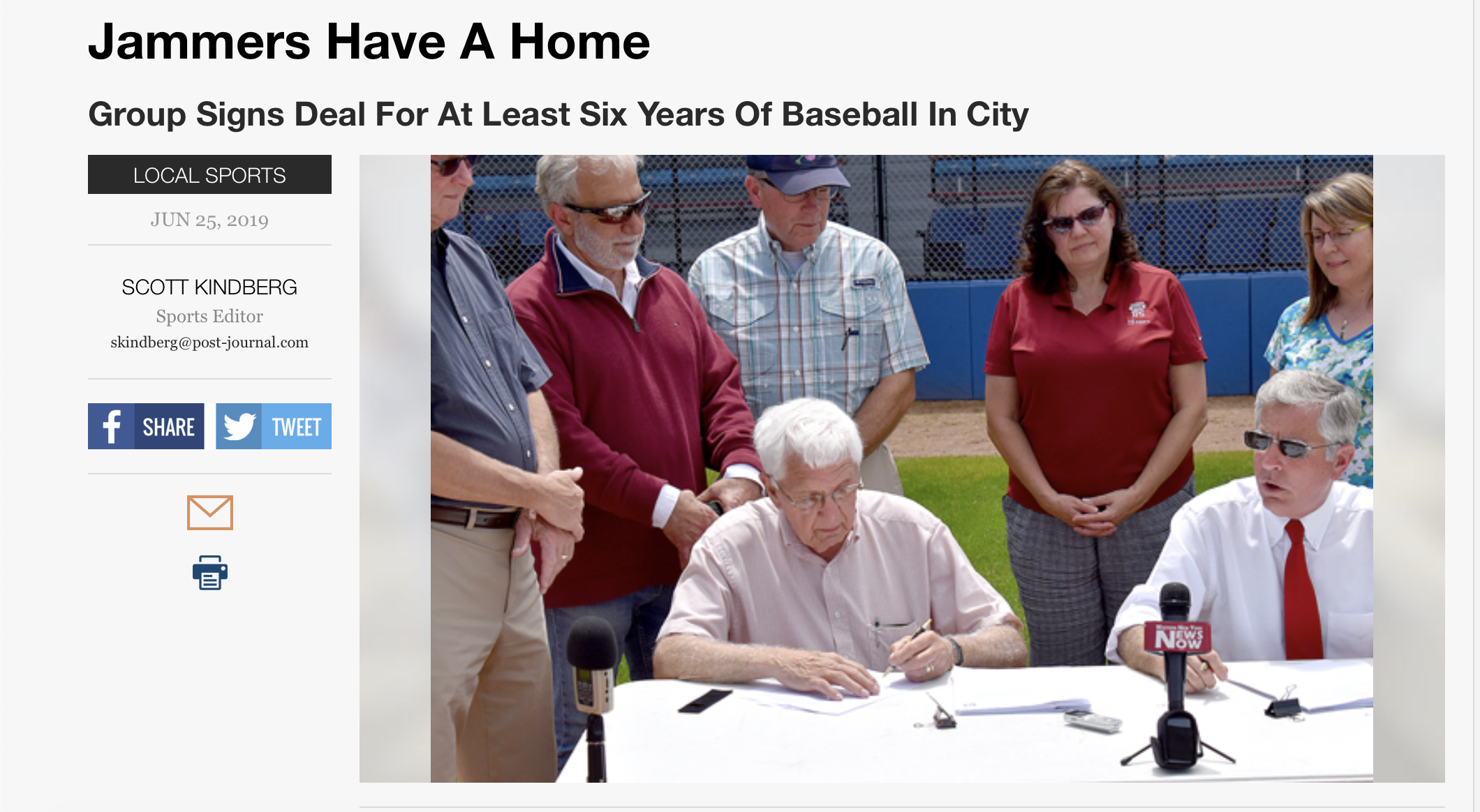 """With Jamestown mayor Sam Teresi looking on at right, Russell E. Diethrick Jr. signs a lease transfer Monday afternoon establishing Jamestown Community Baseball LLC as the primary tenant of the ballpark that bears his name. Diethrick is the president of the JCB board of directors."""