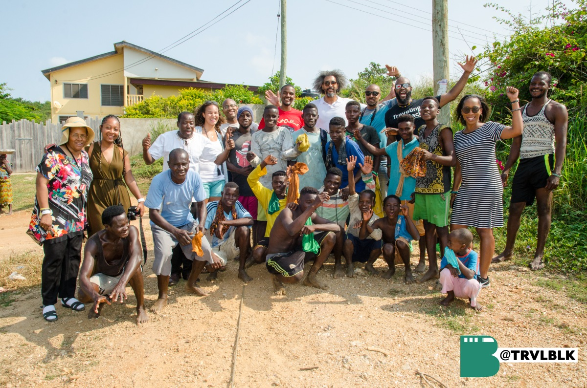The Traveling Black group with local people in a small fishing village near Cape Coast. Photo credit: Kumi Rauf, Founder - Traveling Black