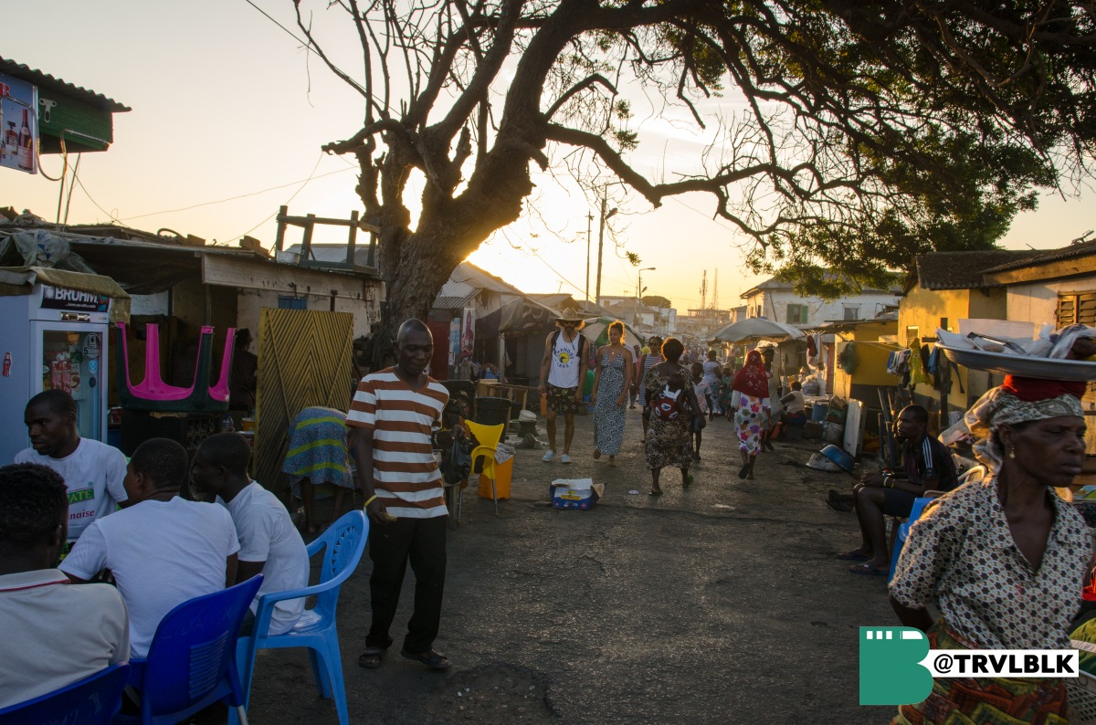 An image of the group exploring Jamestown at sunset - a fishing village and one of the oldest settlements in Accra. Photo credit: Kumi Rauf, Founder - Traveling Black