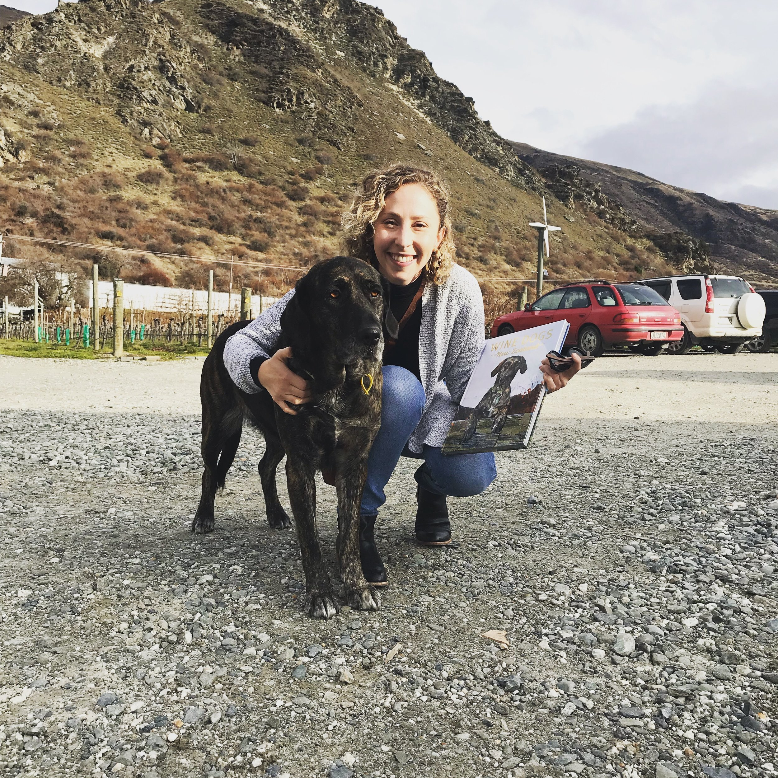 Posing with Phoebe, one of the 'wine dogs' and book cover star, outside of Brennan Wines Central Otago