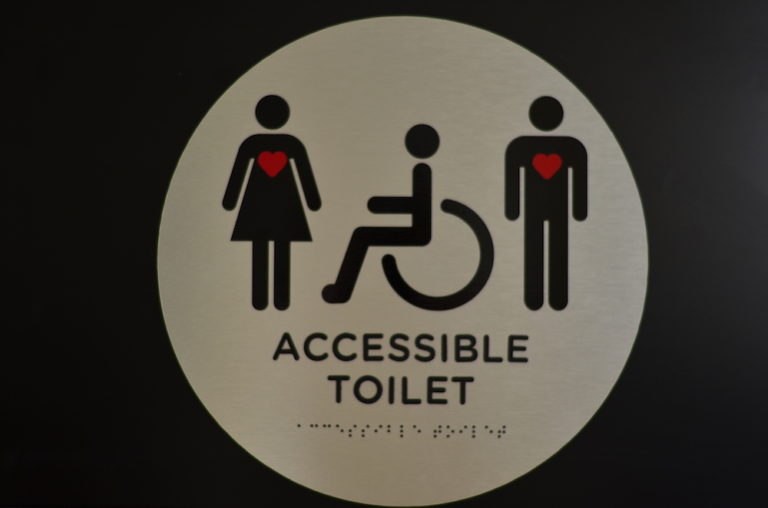Source: Points of Light; Pictured Grace Warnock's invisible disability sign