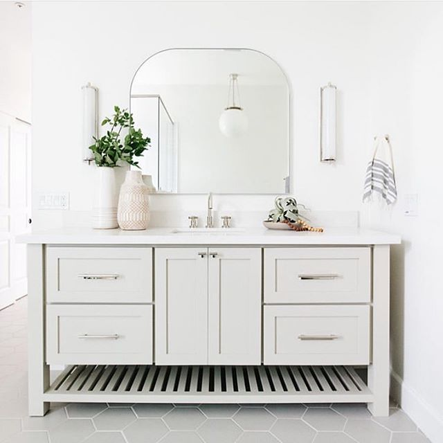 Happy Monday from this bright and cheery bathroom we recently completed.  For this project, we teamed up with the amazing women @lexigracedesign to bring their designs to life for our shared clients.  It was a pleasure working side by side with them to create these beautiful spaces.  Excited to share more!  Design & Styling: @lexigracedesign  Build: @gatherprojects 📷: @rennaihoefer  #housetour #finditstyleit #homerenovation #modernhome #interior123 #whitedecor #Homedesign #Homedecor  #interiorlovers #howihaven #sodomino #dreambuildgather  #bathroom