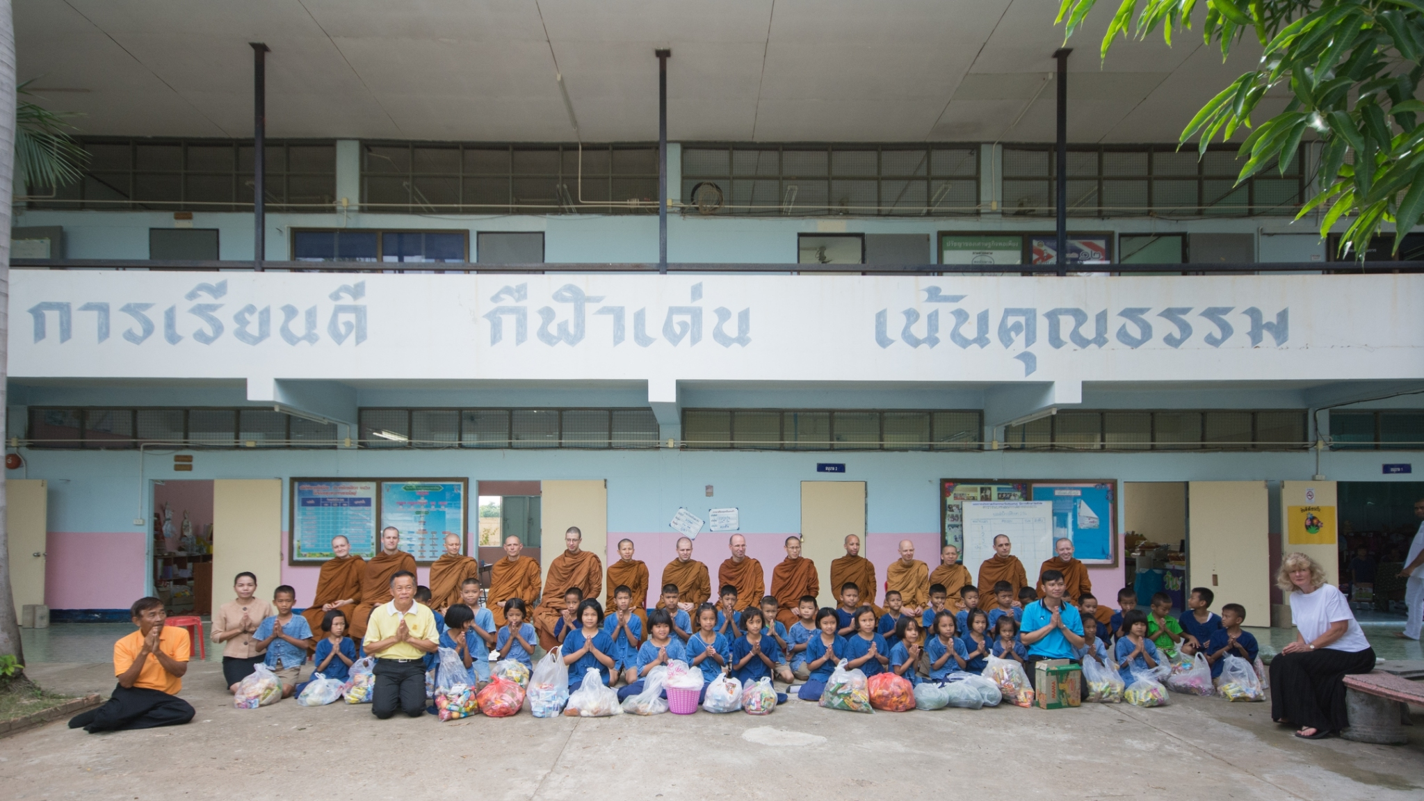 Distributing left over almsfood to a school in Mukdahan