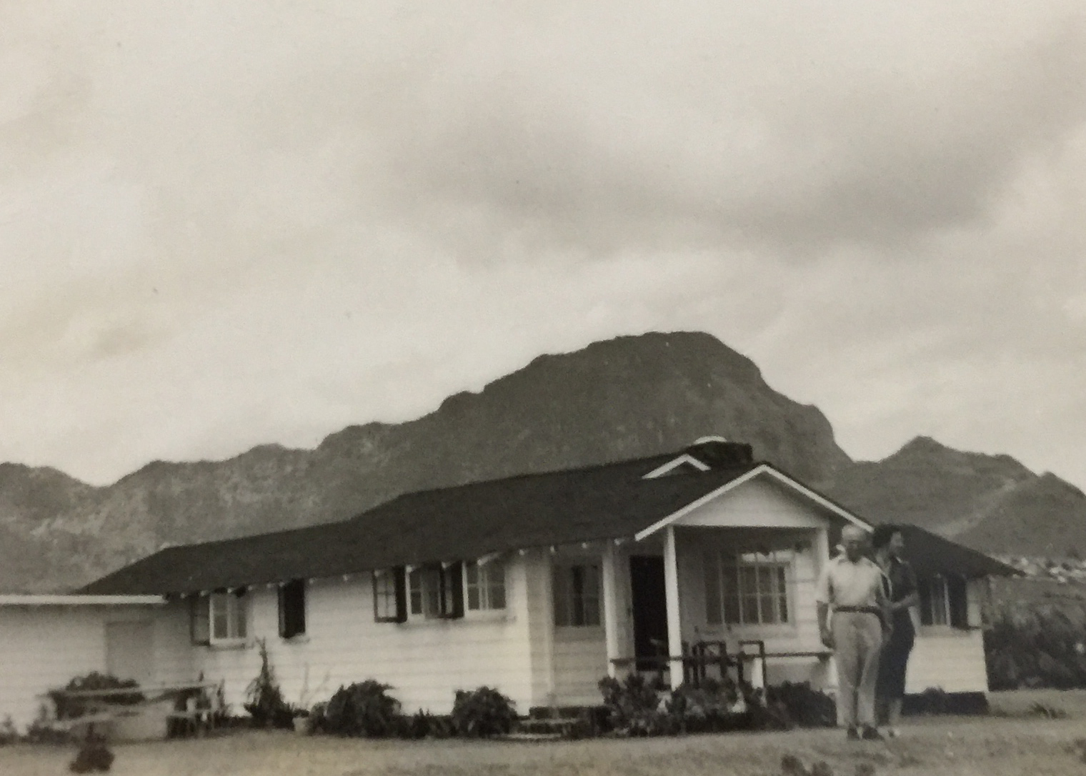Elbert and his wife in front of the original Gillin House, circa 1951