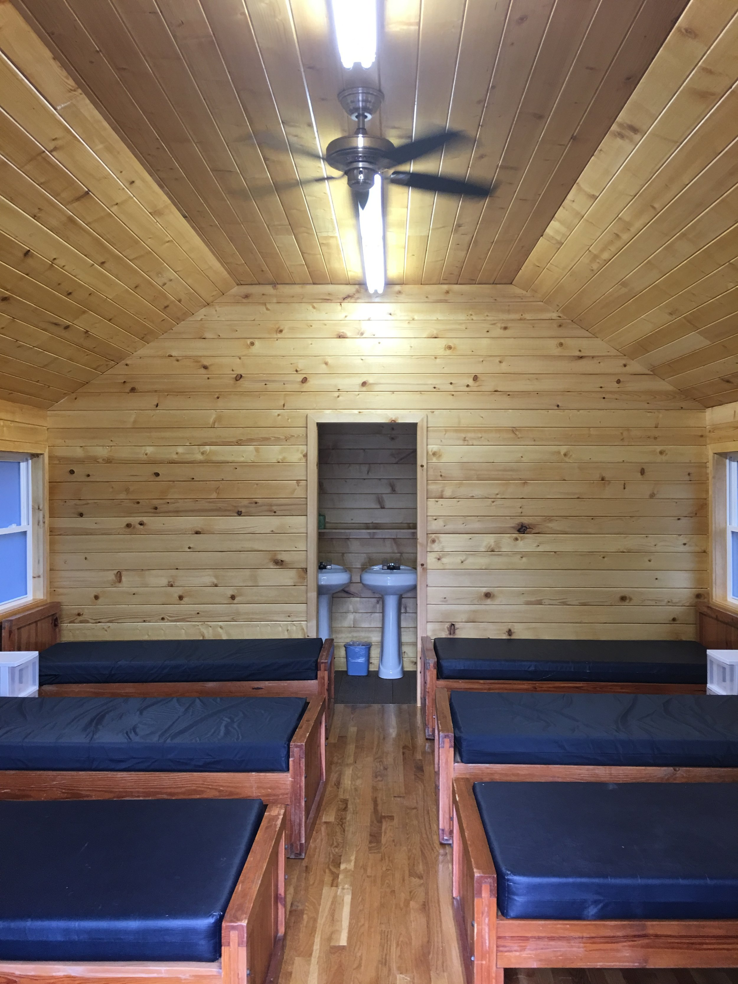 A typical cabin sleeps several people. Bath/shower in rear of cabin.