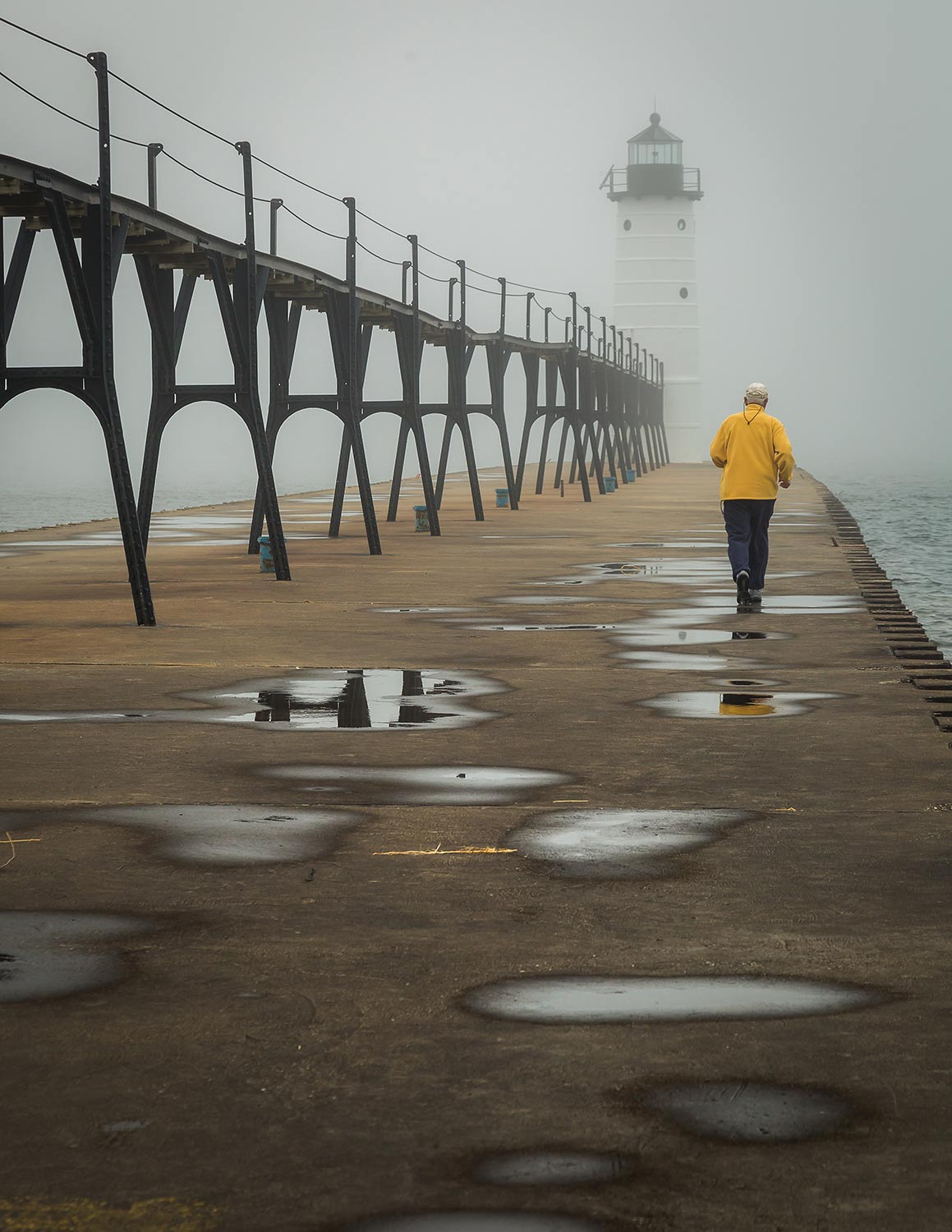 A morning walk out to the Manistee Lighthouse as the fog moves in from Lake Michigan.