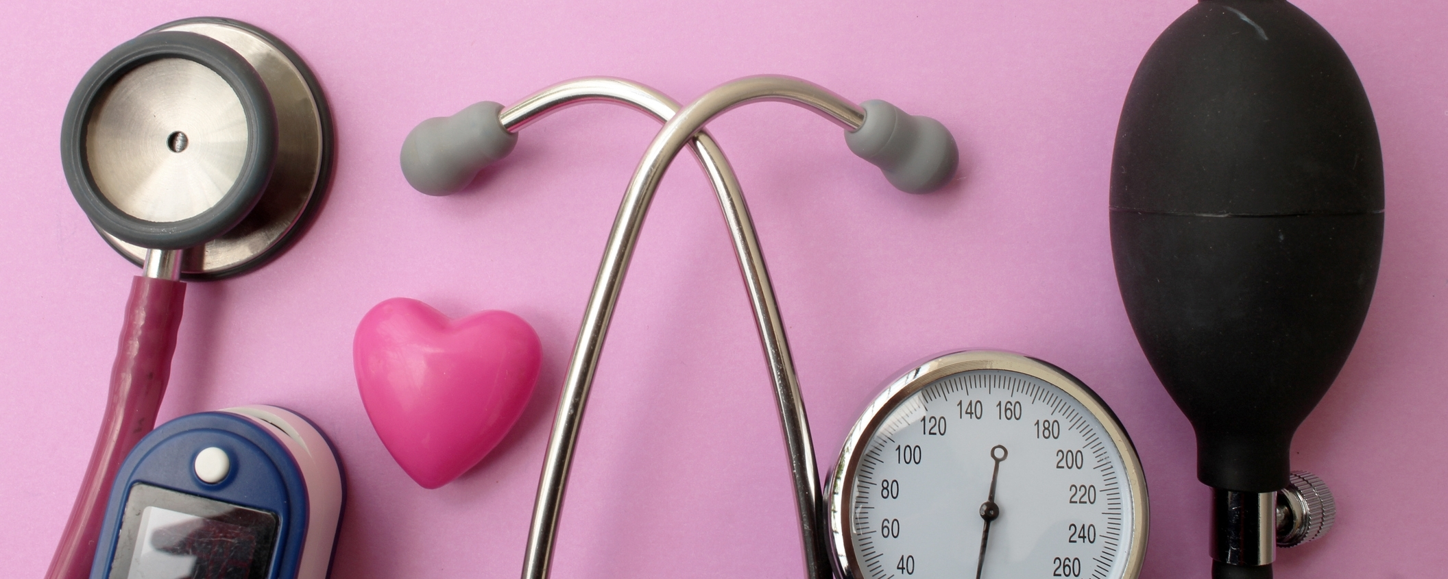 Image: Medicine concept - stethoscope, blood pressure equipment, heart and pulse oximetere on pink background