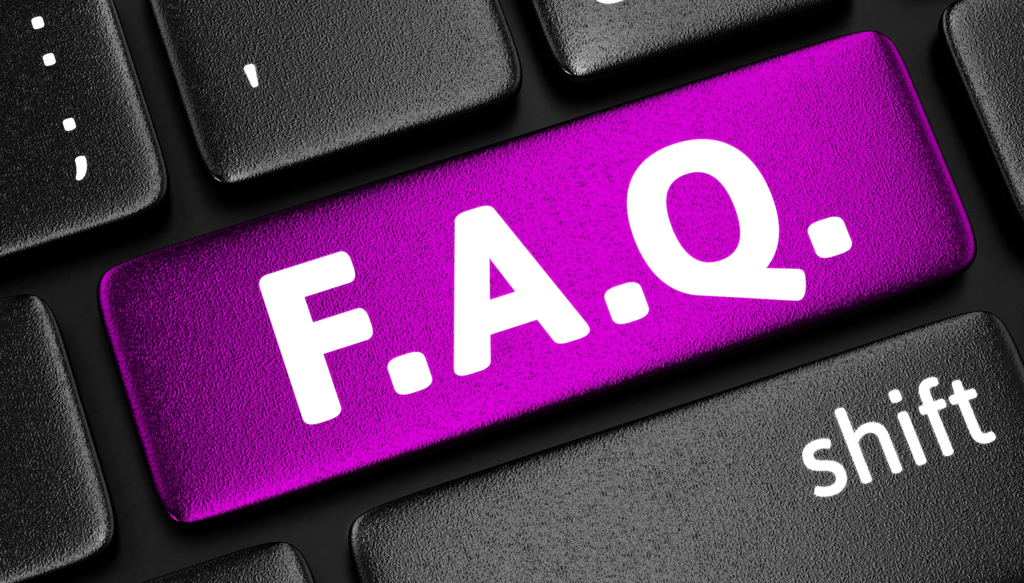 Image: A purple F. A. Q. key on a black keyboard.
