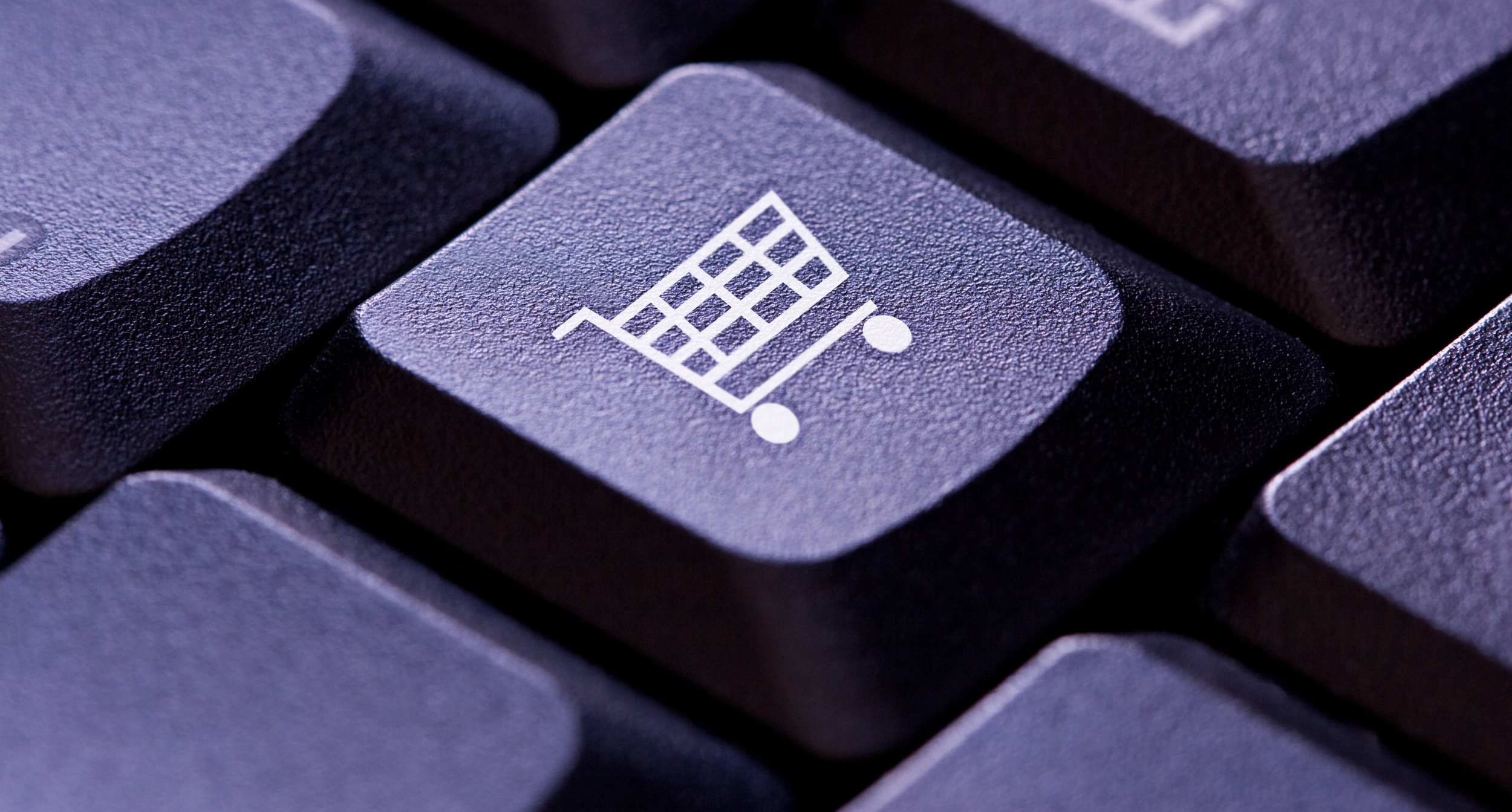 Image; A purple keyboard, with the photo centered on one key which features the logo of a shopping cart.