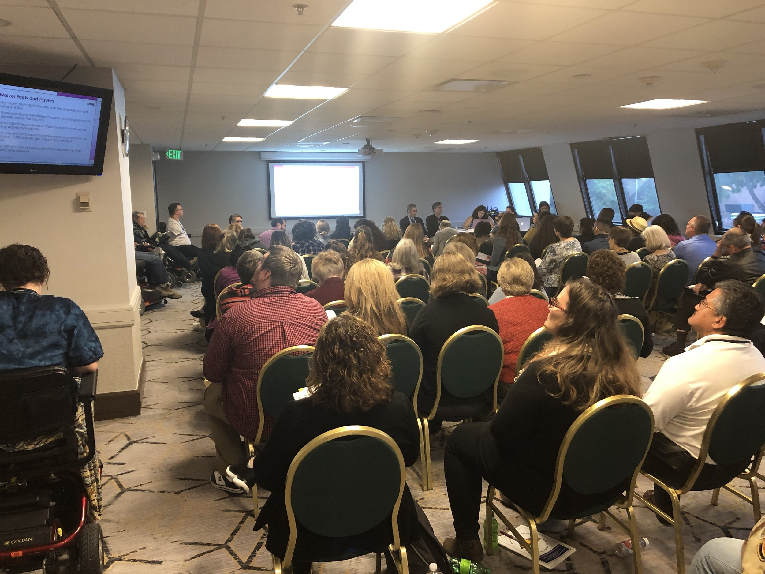 Picture: CHRIL presentation at the APRIL Conference. Picture is of a room with audience members looking toward the front of the room as CHRIL presenters speak.