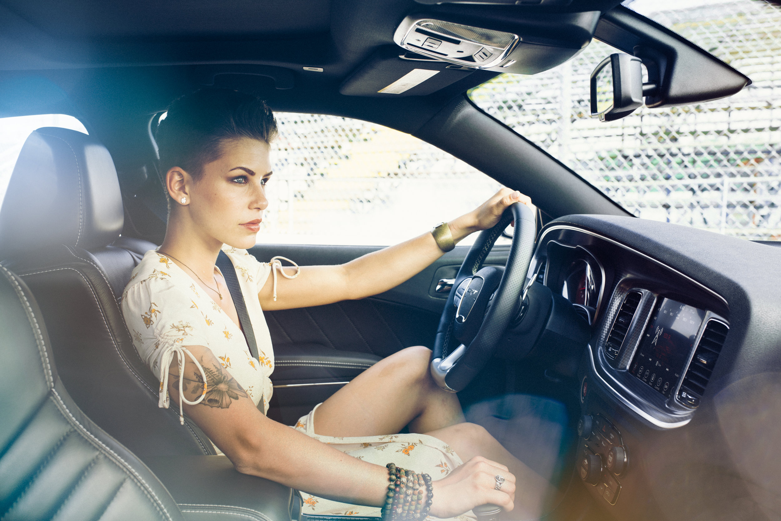 Jasmine white dress driving_CHARGER_HELLCAT_YELLOW_INTERIOR_D827002.jpg