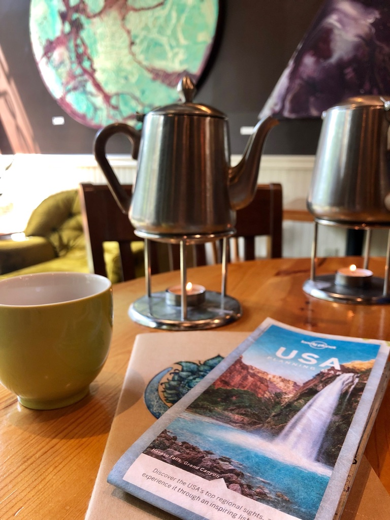 Planning the next few days of our trip with a free pot of tea from townshends thank you punch card