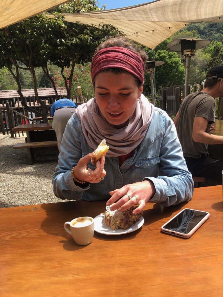 Emma thoroughly enjoying her croissant