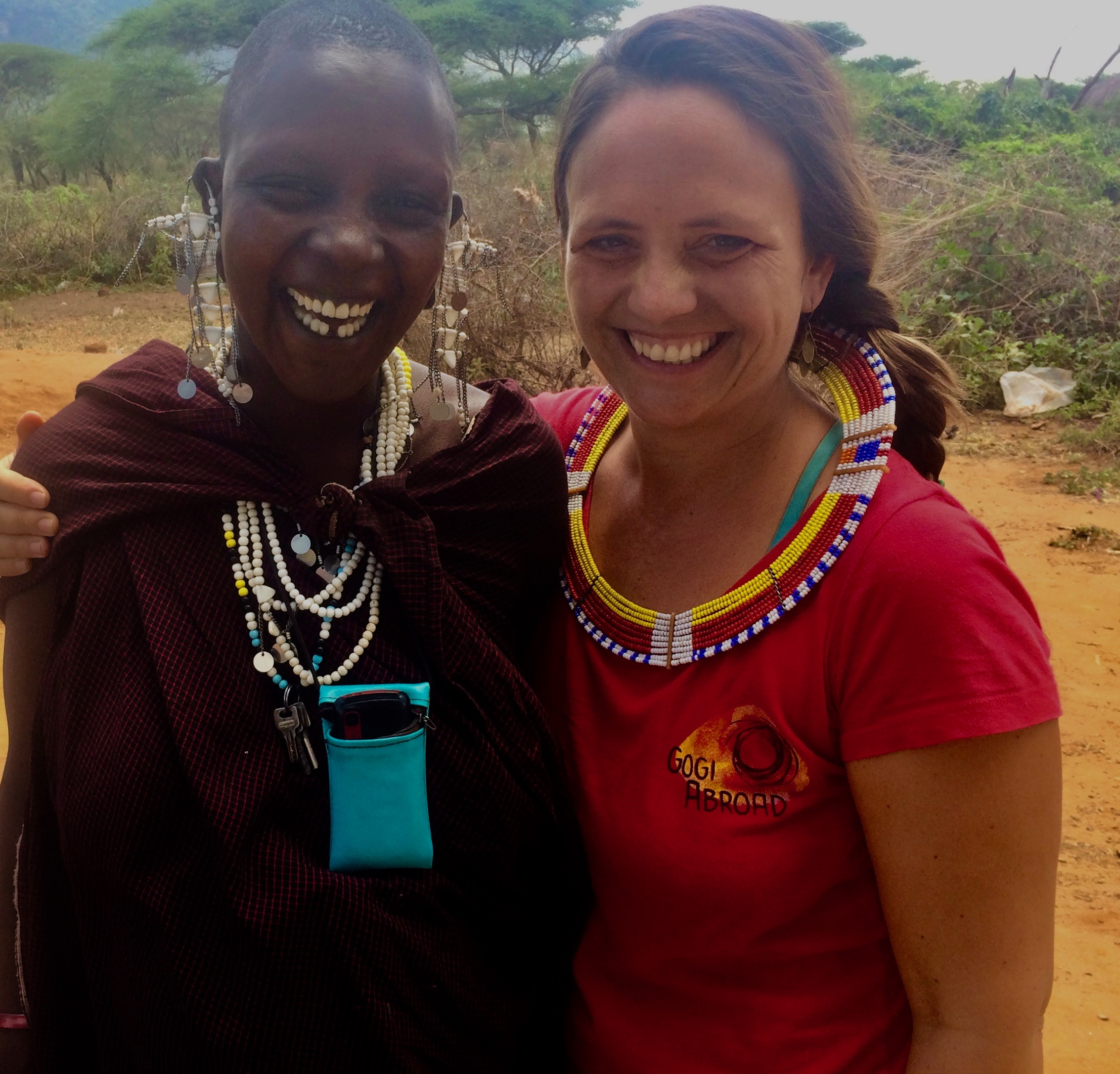 Liz Jackson, Gogi Abroad founder, with a friend and member of the the Beading Collective in Tanzania