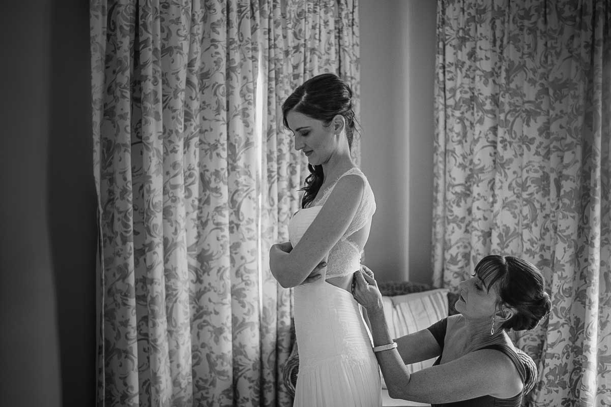 Mom helping bride get ready london wedding photographer.jpg