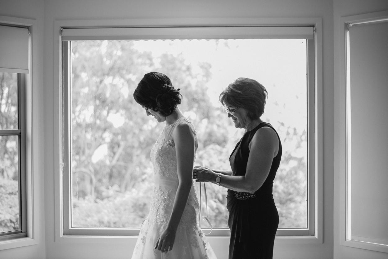 mother helping bride london documentary wedding photography.jpg
