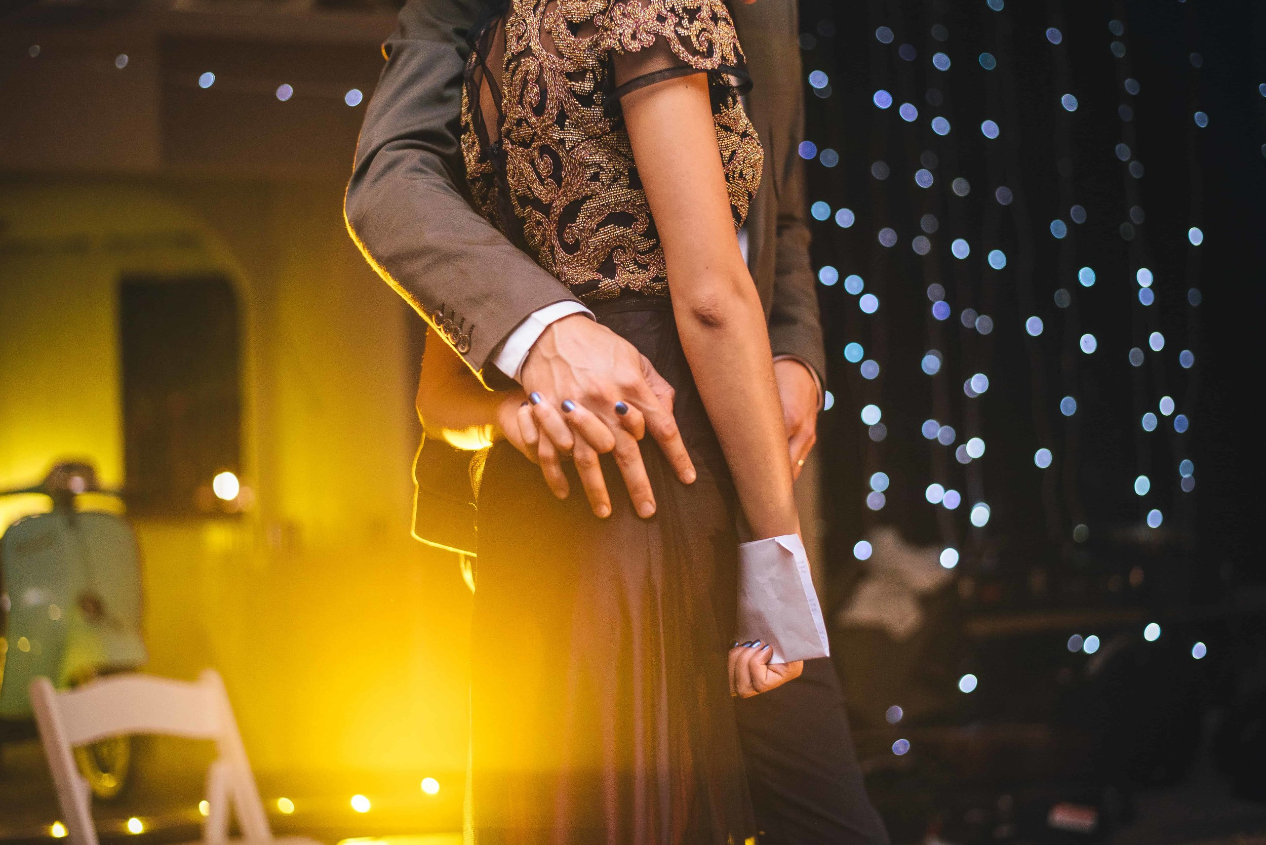 Alternative Bride & Groom Hold Hands at London Wedding Reception