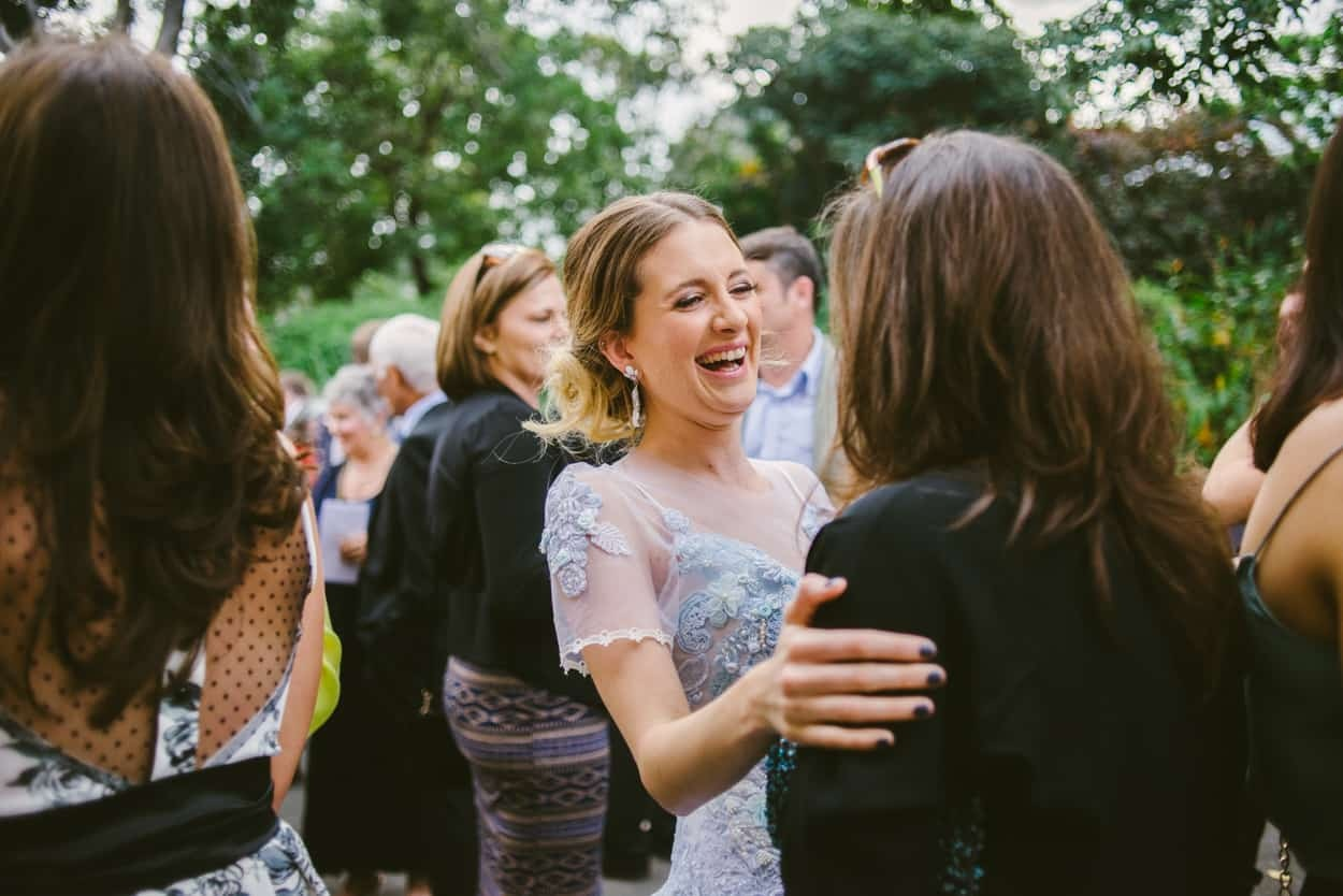 Bride greeting guest London wedding photography