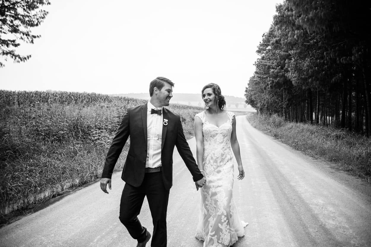 Bride and Groom walk down English countryside