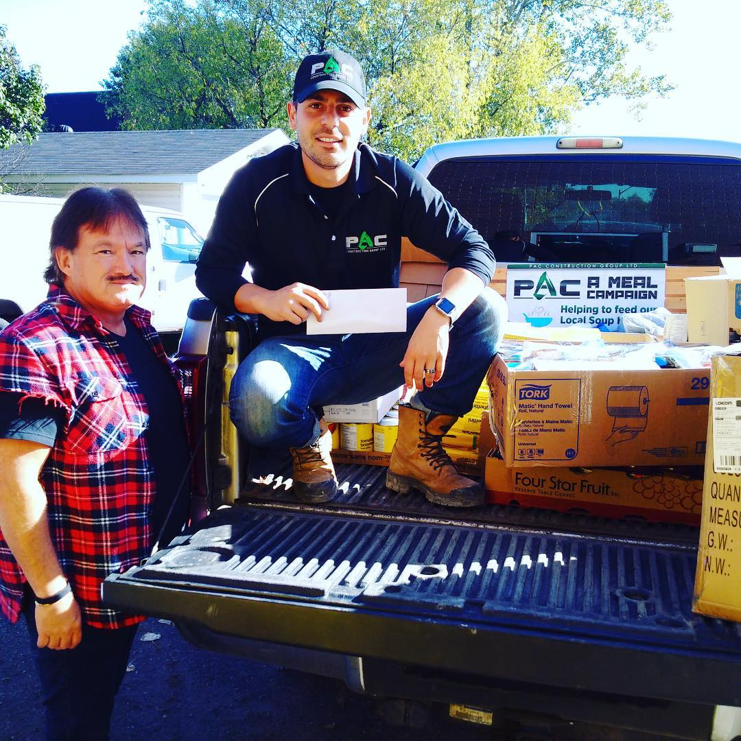 General Manager Ron Sim From The Community Soup Kitchen Accepting One Of Our Donations.